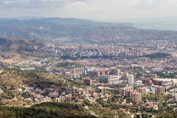 Sunny View of Barcelona city from the Mount Tibidabo, Catalonia,