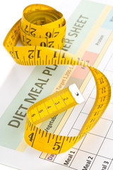 Dieting weight loss concept - measurement tape on meal planning