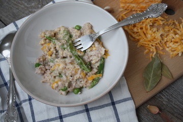 hot risotto with cheese, cream sauce and garlic. hot European dish.