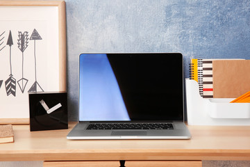Modern workplace with laptop at home