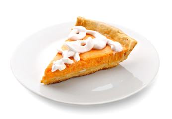Plate with delicious pumpkin cake on white background