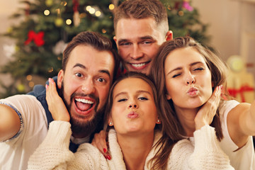 Group of friends taking selfie during Christmas