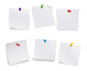 Set of white note papers with different color pushpins