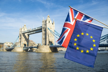 European Union and British Union Jack flag flying in front of Tower Bridge in a statement of the Brexit EU referendum in London, UK