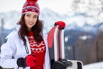 beautiful woman with a snowboard