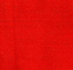 Natural background of thick orange red  fabric. Fabric texture  for background.