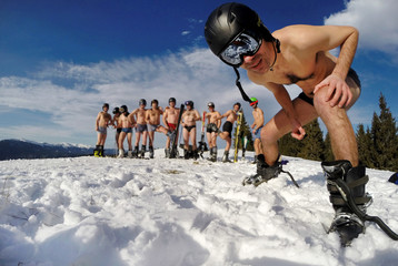 Skiers posing in underwear in the snow
