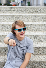 Portrait of  teenage boy pointing at the camera.