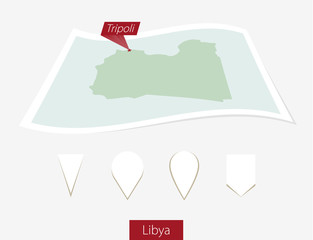 Curved paper map of Libya with capital Tripoli on Gray Background. Four different Map pin set. Vector Illustration.