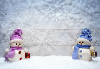 Snowmen on winter background