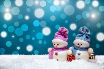 Couple of snowmen on blue winter background