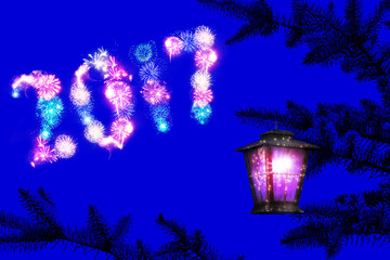 2017 NEW YEAR. Holiday fireworks glowing on the dark blue night sky. Vintage magical lighting lantern hangs on a christmas tree with sparkles. Christmas (New Year) fairy composition