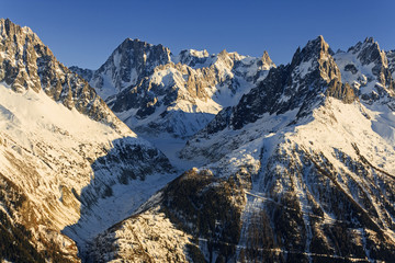 Winter mountain landscape at sunset in Alps.