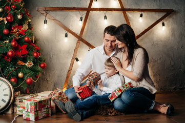 happy young family in Christmas decorations