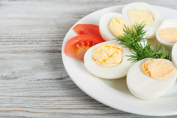 Boiled hen eggs and tomato