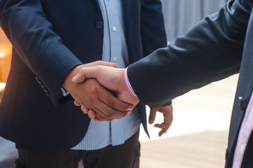 Business handshake of two men demonstrating their agreement to s