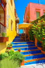 Cozy small Cretan cafe and colorful stairs between nice Cretan houses in Rethymnon, Island Crete, Greece