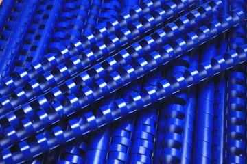 many blue plastic binding combs-clouseup.