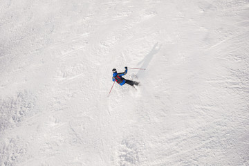 A skier on a ski slope.