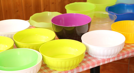 many empty plastic bowls on the table