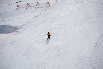 Little skier on a ski slope.