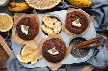 Vegan Muffins with lemon and lemon in bakeware. Top view