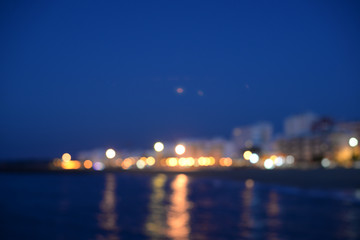 Bokeh city or ship night lights reflection view blur background
