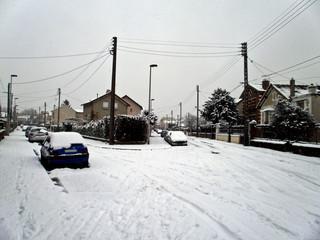 a street full of snow aroud christmas