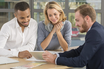 Mutiracial couple with a .real estate agent