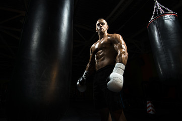 boxer in gym with punching bag