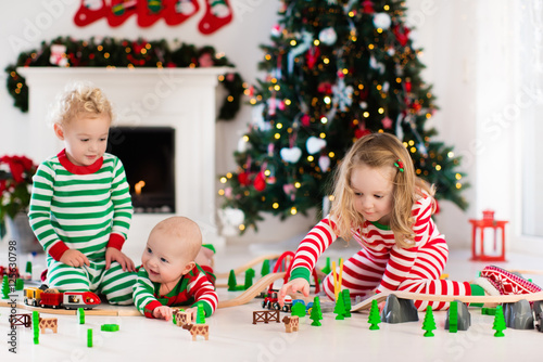 Kids playing with christmas toys