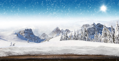 Empty wooden planks with winter alpine mountains