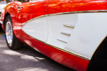 Foto op Canvas Snelle auto s Doors of a red and white vintage car
