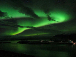 Beautiful Aurora Borealis Dancing in the Night Sky over Jokulsarlon Glacier Lagoon, South Iceland