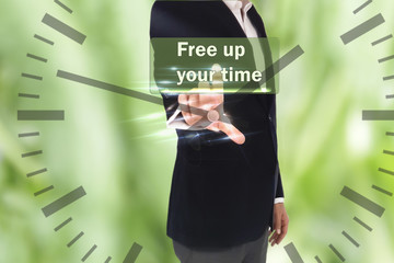 business, technology, internet and networking concept - businessman pressing FREE UP YOUR TIME  button on virtual screens and clock, blurred of green nature outdoor bokeh background