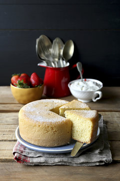 Freshly baked sponge cake with whipped cream and strawberry