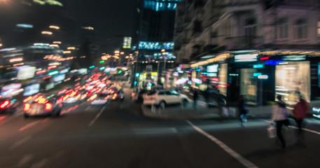 Night city street lights background. Blurred motion