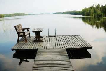 Lake with small wooden platform for rest