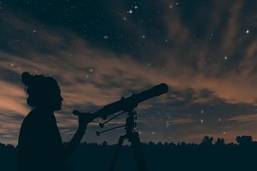 Woman with telescope. Night sky, with clouds and constellations, Aquarius, Aguila, Scutum, Ophiuchus, Serpens, Sagittarius, Capricornus.