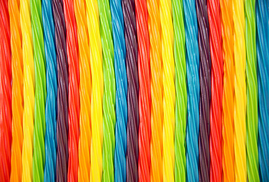 background of rainbow twisted candy. colorful twisted licorice candy, texture