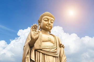 Fotobehang Fontaine Buddha statue on the blue sky