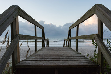 Beach access.  Boardwalk to the ocean at sunrise.  Welcome.  Joyful entrance.