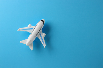 toy plane on blue paper background Wall mural