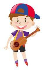 Happy boy with ukulele