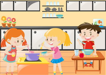 Three kids cooking and eating in kitchen