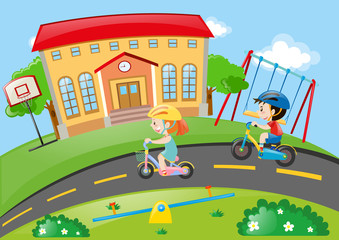 Boy and girl cycling on road