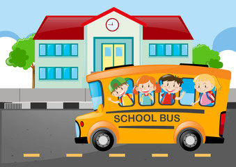 Kids riding on school bus to school