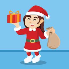 santa girl holding sack of gift