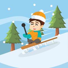 boy sliding with sled