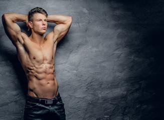 Sporty male on grey background.